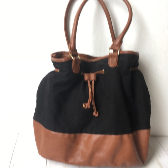 Black and Tan Faux Leather Bucket Bag. M 5b84aea5bf77296148657bb6 60be36c8e4079